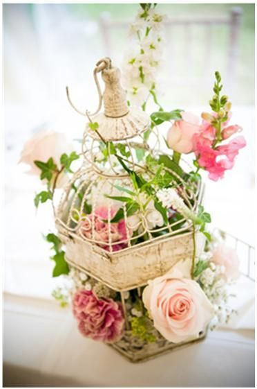 I'm thinking of finding old bird cages and decorate them with flowers and maybe candles/Hanna vintage birdcage with flowers