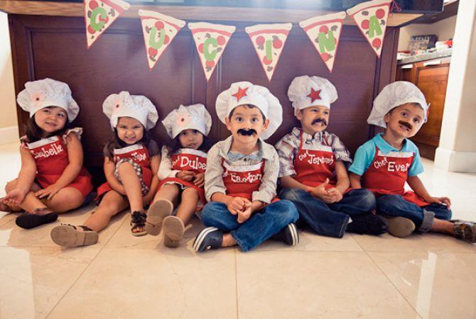 Crianças em festa infantil com tema pizza